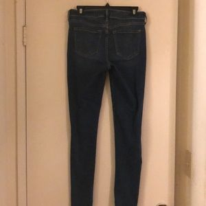 Old Navy Rock Star mid rise distressed jeans.